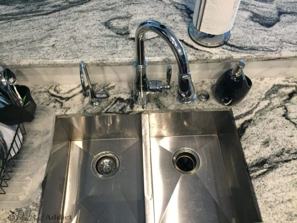 moen sink disposal button faucet