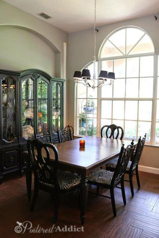 Dining room - zebra chairs and painted china cabinet
