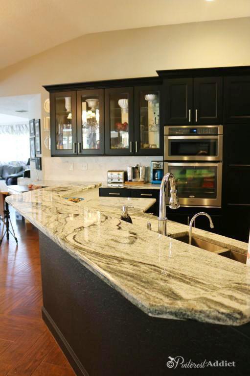 Granite counters - black kitchen - mirrored cabinets