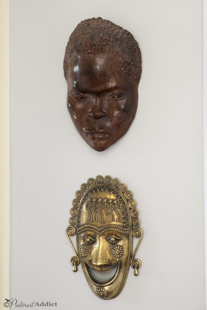Thrift Store Art - Carved African mask and Brass Mask