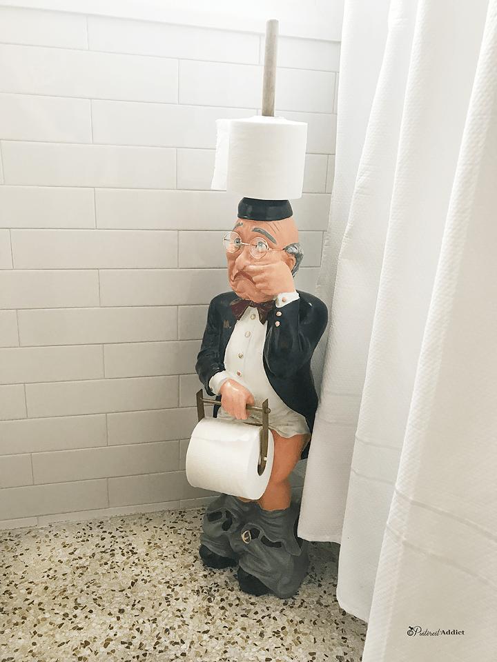 1950's Guest bathroom makeover - terrazzo floors subway tile wainscoting butler toilet paper holder