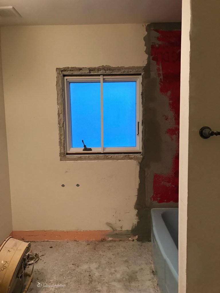 Bathroom demo - vintage blue tile around shower and window