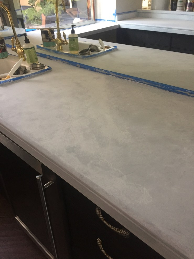 building texture and depth. Faux marble counters