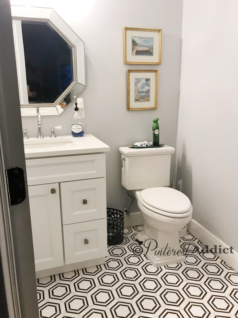 hexagon tile in powder room with white cabinet and octagon mirror