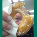 Carrington Vanston holding a donut