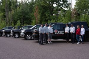 A Plus Pest Management team with the service trucks