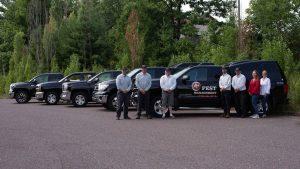 A Plus Pest Management Team and Trucks