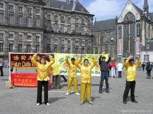 Followers of Falun Gong practicing Falun Dafa exercises on Dam Square, Amsterdam