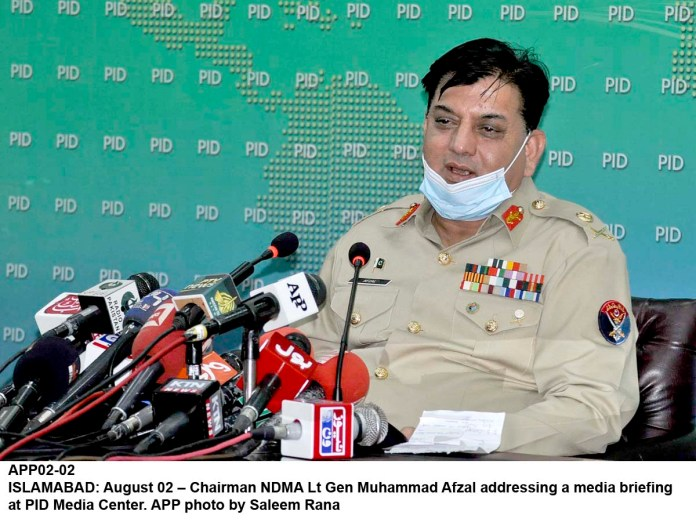 ISLAMABAD: August 02 – Chairman NDMA Lt Gen Muhammad Afzal addressing a media briefing at PID Media Center. APP photo by Saleem Rana