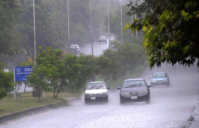 ISLAMABAD: August 28 – A view of heavy rain shower at ZeroPoint area in the federal capital. APP photo by Irfan Mahmood