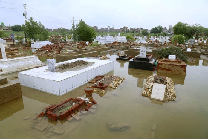 HYDERABAD: August 27 – A view of cantonment graveyard submerged in rain water due to heavy rain. APP photo by Akram Ali