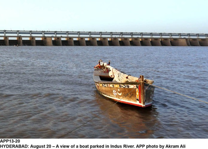HYDERABAD: August 20 – A view of a boat parked in Indus River. APP photo by Akram Ali