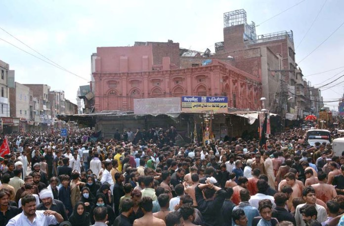 FAISALABAD: August 30 - A large number of mourners attending the procession on Youm-e-Ashura, the 10th day of Muharram-ul-Harram. Ashura marks the death anniversary of Imam Hussain ibn Ali (AS), (the grandson of Prophet Mohammad (PBUH)) a 7th century revolutionary leader who was martyred in the battle of Karbala. The day of Ashura is recognised by millions across the world to remember Imam Hussain's dignified stand for social justice. APP photo by Tasawar Abbas