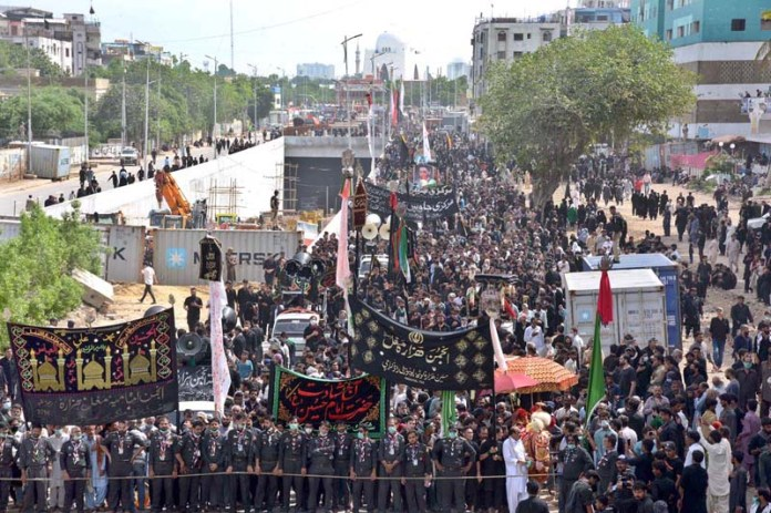 KARACHI: August 30 – The procession of Aashura passing through M A Jinnah road on Youm-e-Ashura, the 10th day of Muharram-ul-Harram. Aashura marks the death anniversary of Imam Hussain ibn Ali (AS), (the grandson of Prophet Mohammad (PBUH)) a 7th century revolutionary leader who was martyred in the battle of Karbala. The day of Ashura is recognised by millions across the world to remember Imam Hussain's dignified stand for social justice. APP photo by M.Saeed Qureshi