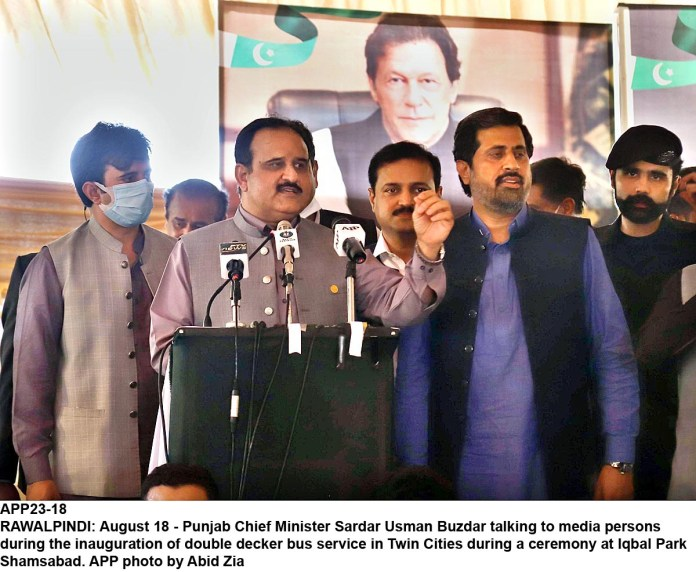 RAWALPINDI: August 18 - Punjab Chief Minister Sardar Usman Buzdar talking to media persons during the inauguration of double decker bus service in Twin Cities during a ceremony at Iqbal Park Shamsabad. APP photo by Abid Zia