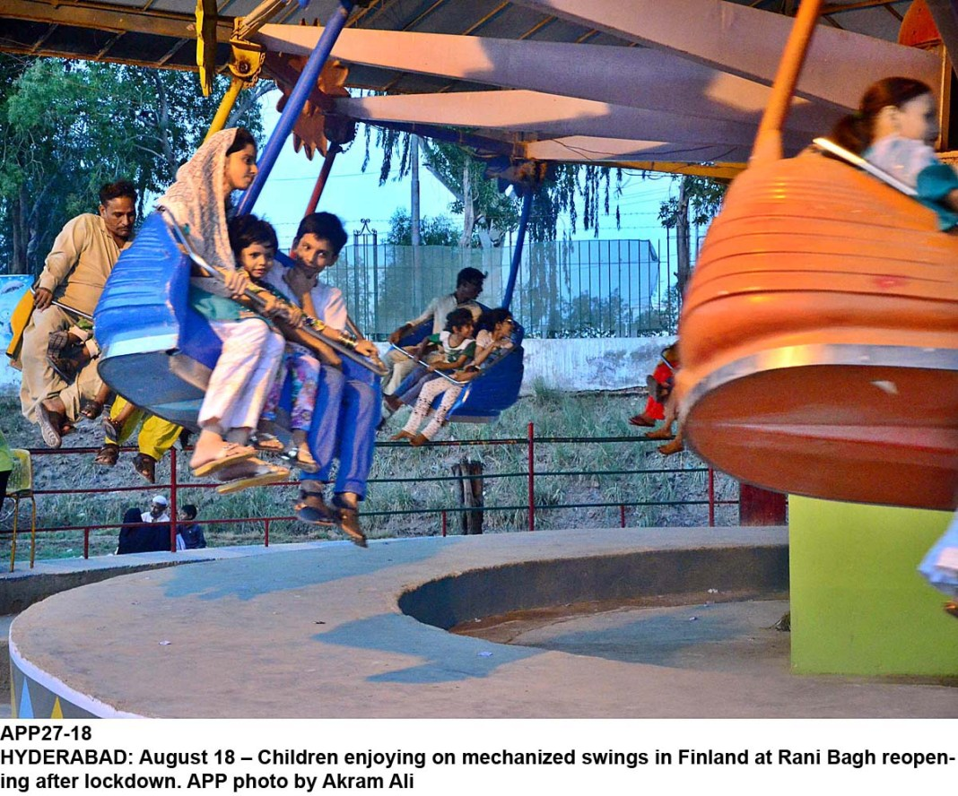 HYDERABAD: August 18 – Children enjoying on mechanized swings in Finland at Rani Bagh reopening after lockdown. APP photo by Akram Ali