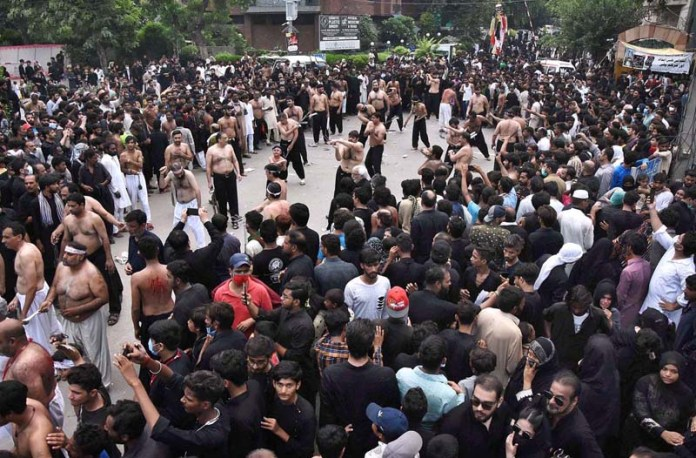 LAHORE: August 30 - A large number of mourners oozing themselves to blood during the procession of Youm-e-Ashura, the 10th day of Muharram-ul-Harram. Aashura marks the death anniversary of Imam Hussain ibn Ali (AS), (the grandson of Prophet Mohammad (PBUH)) a 7th century revolutionary leader who was martyred in the battle of Karbala. The day of Ashura is recognised by millions across the world to remember Imam Hussain's dignified stand for social justice. APP photo by Mustafa Lashari