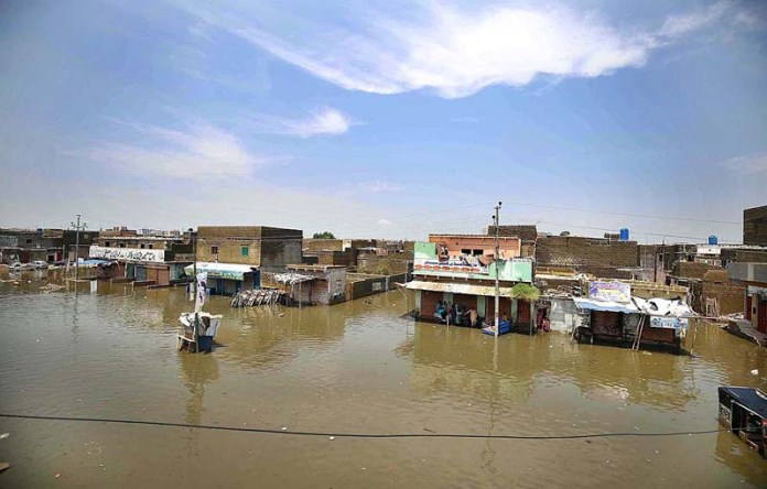 KARACHI: August 23 - The area of Ayub Goth Surjani Town submerged in flooded rainwater a day after heavy downpour. APP photo by Saeed Qureshi