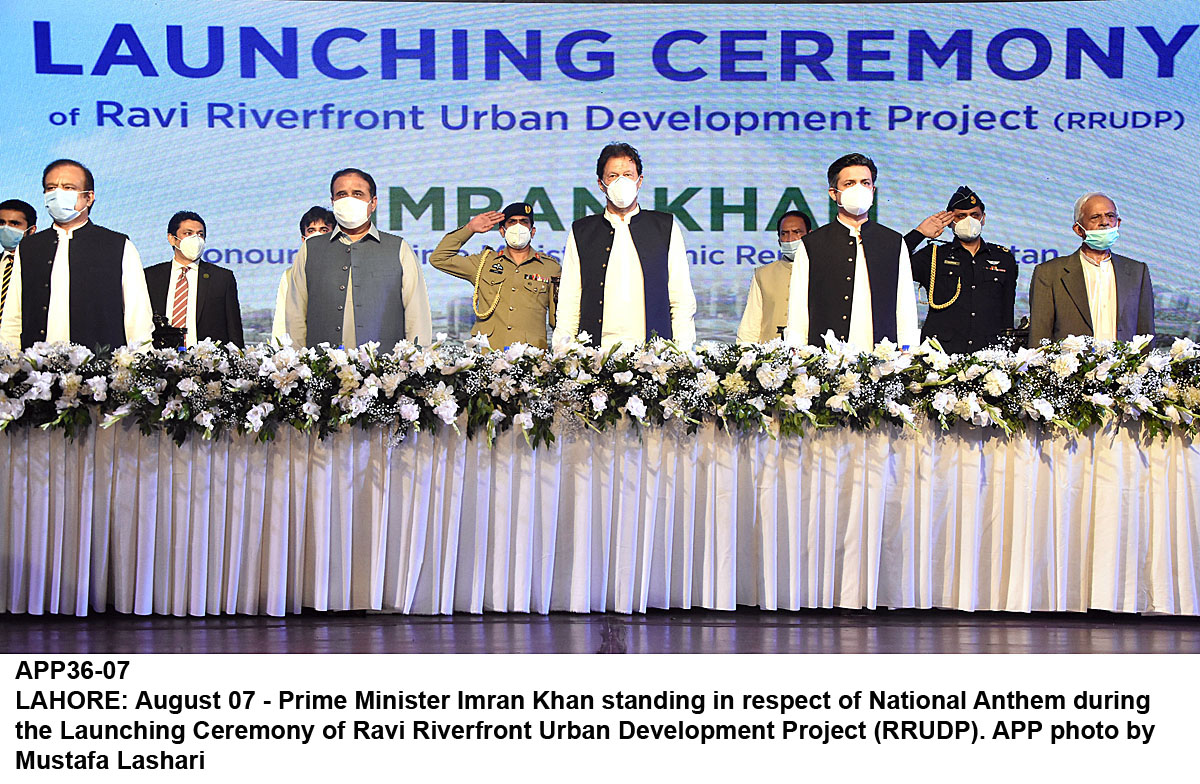LAHORE: August 07 - Prime Minister Imran Khan standing in respect of National Anthem during the Launching Ceremony of Ravi Riverfront Urban Development Project (RRUDP). APP photo by Mustafa Lashari