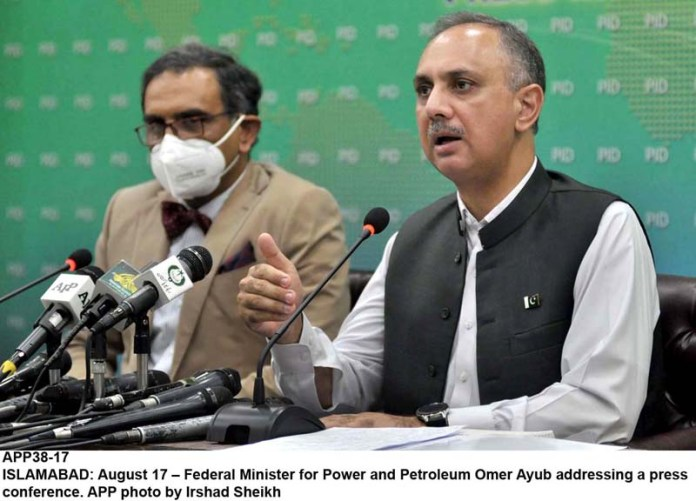 ISLAMABAD: August 17 – Federal Minister for Power and Petroleum Omer Ayub addressing a press conference. APP photo by Irshad Sheikh