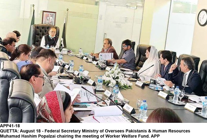 QUETTA: August 18 - Federal Secretary Ministry of Oversees Pakistanis & Human Resources Muhamad Hashim Popalzai chairing the meeting of Worker Welfare Fund. APP