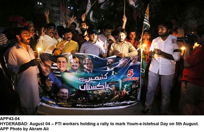 HYDERABAD: August 04 – PTI workers holding a rally to mark Youm-e-Istehsal Day on 5th August. APP Photo by Akram Ali