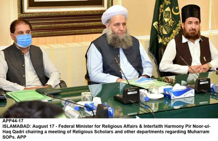 ISLAMABAD: August 17 - Federal Minister for Religious Affairs & Interfaith Harmony Pir Noor-ul-Haq Qadri chairing a meeting of Religious Scholars and other departments regarding Muharram SOPs. APP