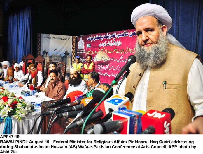 RAWALPINDI: August 19 - Federal Minister for Religious Affairs Pir Noorul Haq Qadri addressing during Shahadat-e-Imam Hussain (AS) Wafa-e-Pakistan Conference at Arts Council. APP photo by Abid Zia