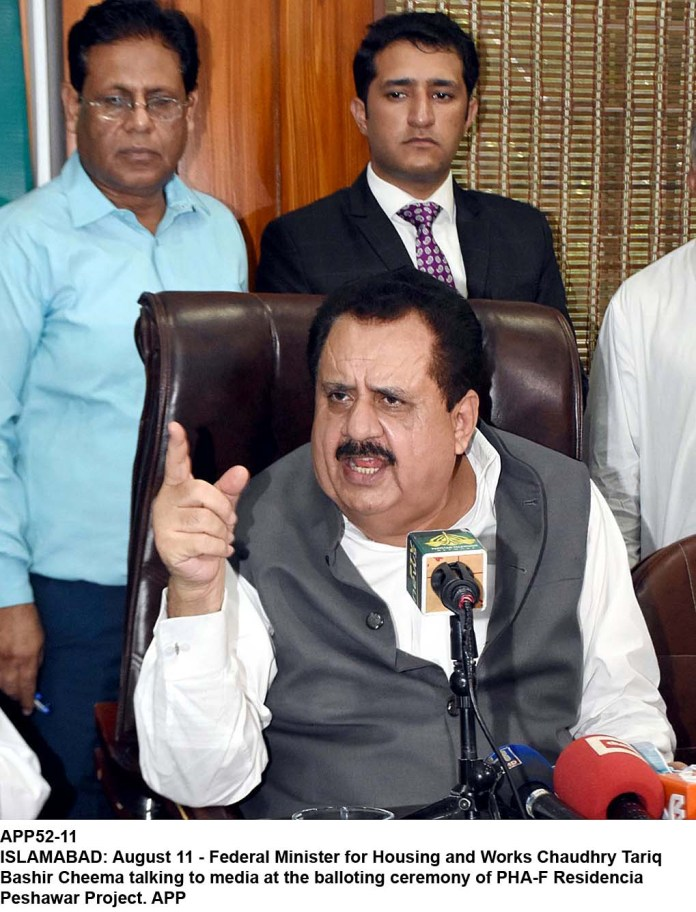 ISLAMABAD: August 11 - Federal Minister for Housing and Works Chaudhry Tariq Bashir Cheema talking to media at the balloting ceremony of PHA-F Residencia Peshawar Project. APP