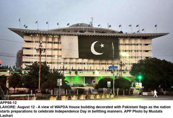 LAHORE: August 12 - A view of WAPDA House building decorated with Pakistani flags as the nation starts preparations to celebrate Independence Day in befitting manners. APP Photo by Mustafa Lashari