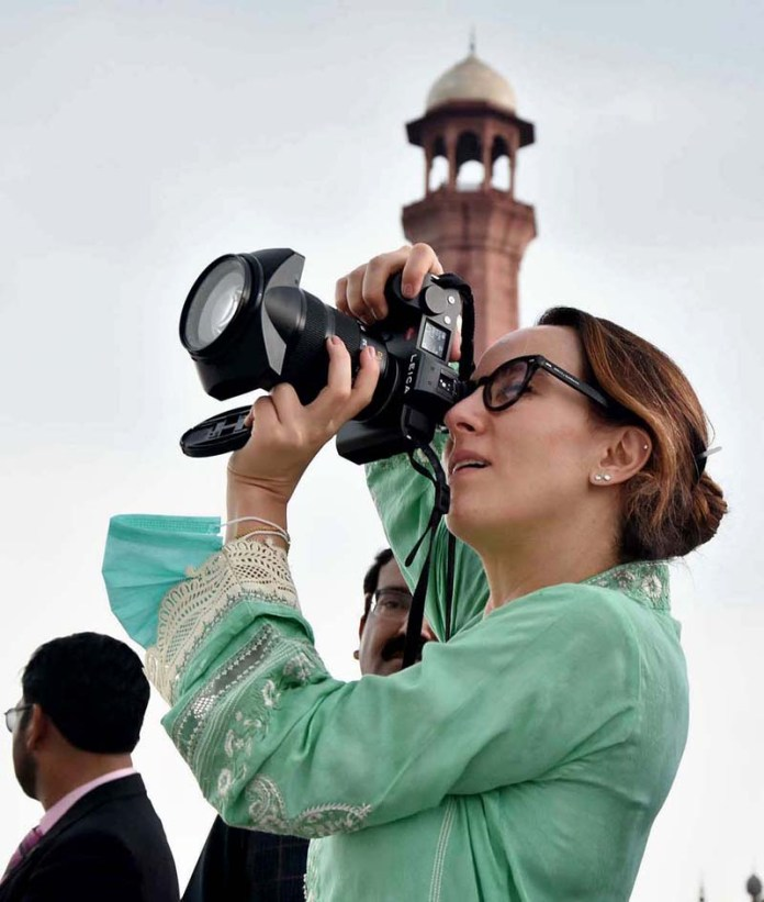 LAHORE: August 26 - President Inter-Parliamentary Union (IPU) Ms. Gabriela Cuevas Barron capturing photo with camera during visit to historic Badshahi Mosque. APP Photo by Mustafa Lashari