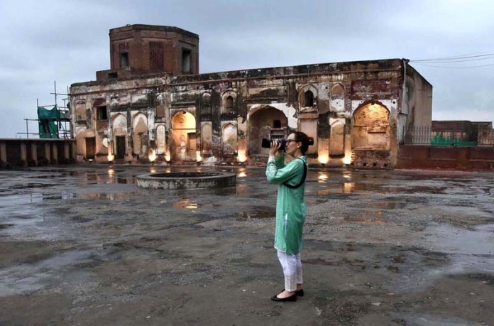 LAHORE: August 26 - President Inter-Parliamentary Union (IPU) Ms. Gabriela Cuevas Barron capturing photograph with camera during visit to historic Royal Fort (Shahi Qilla). APP Photo by Mustafa Lashari