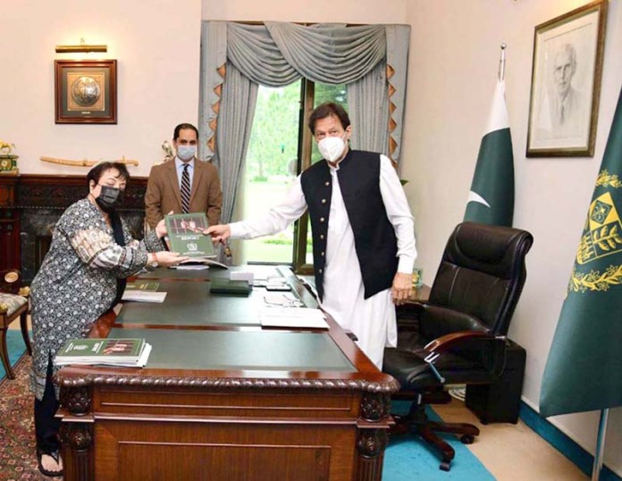 ISLAMABAD: August 26 – Minister for Human Rights Dr. Shireen Mazari presenting Report on Plight of Women in Pakistan's Prisons to Prime Minister Imran Khan. APP