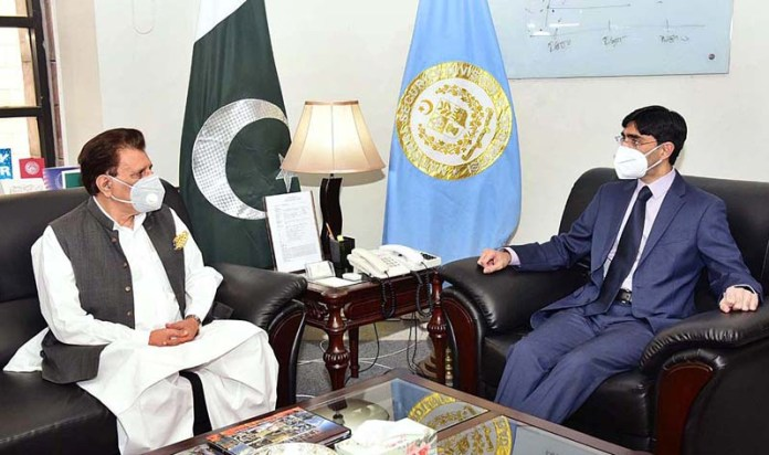 ISLAMABAD: August 26 - PM AJ&K Raja Muhammad Farooq Haider Khan met Dr. Moeed Yusuf, SAPM on National Security and Strategic Policy Planning at the Prime Minister Office. AP