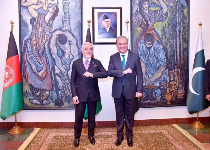 ISLAMABAD: September 28 - Foreign Minister Makhdoom Shah Mahmood Qureshi warmly greets Dr. Abdullah Abdullah, Chairman of the High Council for National Reconciliation (HCNR) Of Afghanistan at foreign office. APP