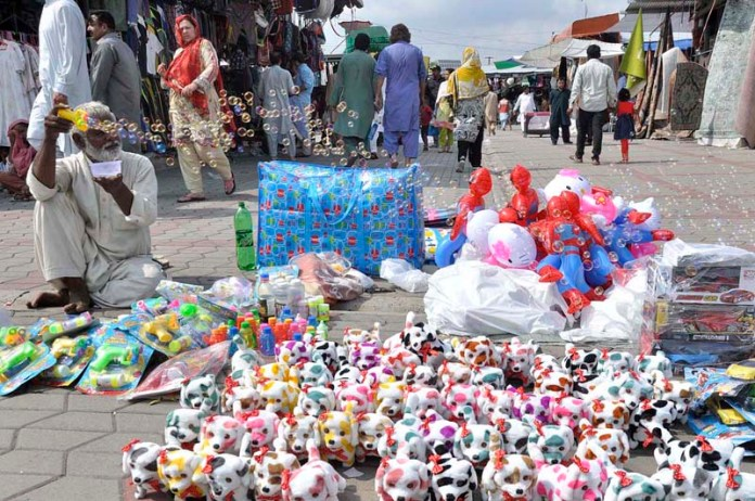 ISLAMABAD: September 06 – A vendor displayed colourful toys to attract the customers in weekly Bazaar in the federal capital. APP photo by Saleem Rana