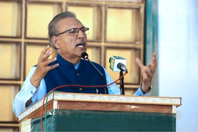 MIRPUUKHAS: September 12 – President Dr. Arif Alvi addressing Ration Distribution Ceremony during his visit to flood affected areas. APP photo by Akram Ali