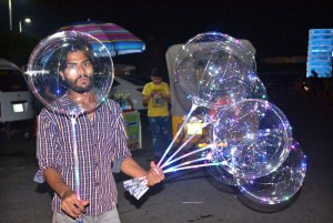 FAISALABAD: September 07 - Street vendor displaying lighting balloons to attract the customers. APP photo by Tasawar Abbas