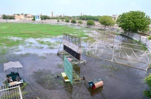 HYDERABAD: September 03 – A view of rain water accumulated at Niaz Cricket Stadium after heavy rain in the city. APP photo by Farhan Khan