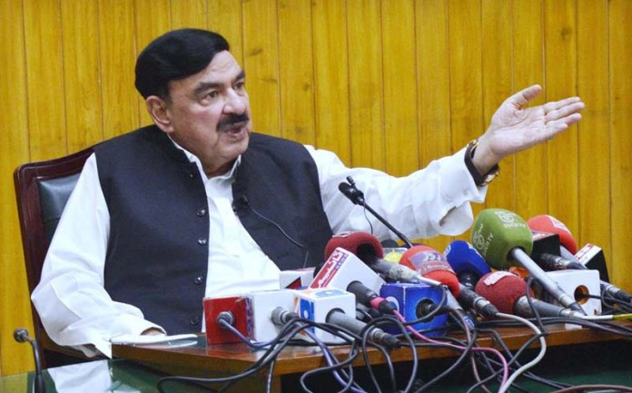 LAHORE: September 12 - Federal Minister for Railways Sheikh Rashid Ahmed addressing a press conference at Railway Headquarters. APP photo by Ashraf Ch