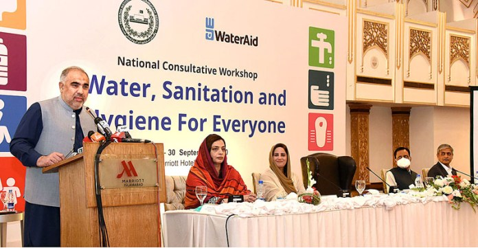 ISLAMABAD: September 29 - Speaker National Assembly Asad Qaiser addressing participants of inaugural ceremony of National Consultative Workshop on Water, Sanitation and Hygiene for Everyone. APP