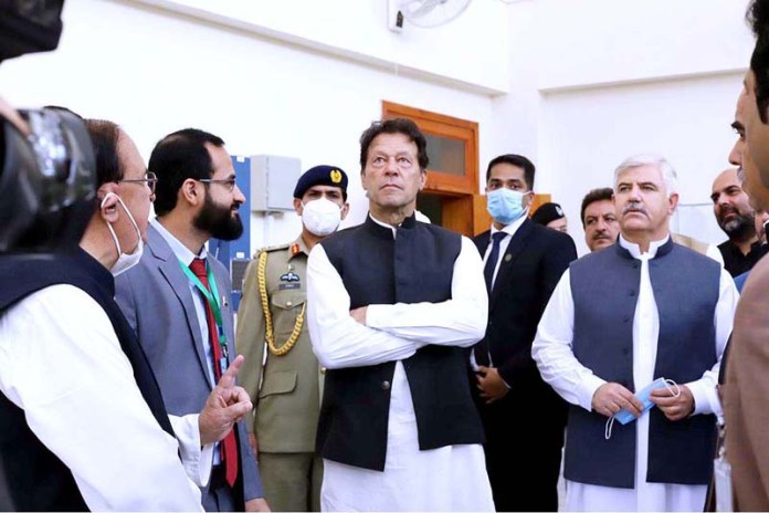 HARIPUR: September 17 – Prime Minister Imran Khan being briefed during visit to Engineering Lab at Pak-Austria Fachhochschule Institute of Applied Sciences & Technology in Mang. APP