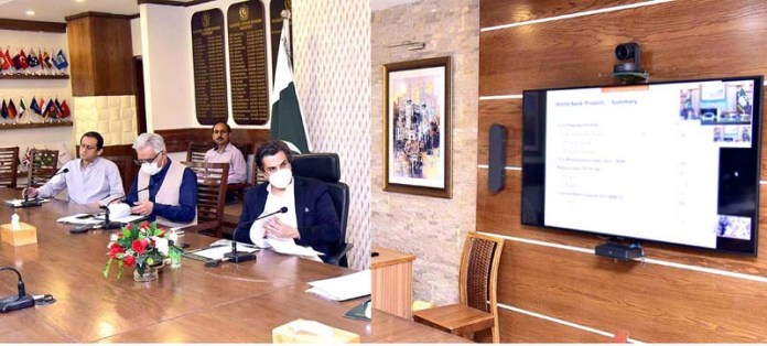 ISLAMABAD: September 11 - Makhdum Khusro Bakhtyar, Minister for Economic Affairs chairing a high-level portfolio review meeting of World Bank-funded projects in Pakistan, at Ministry of Economic Affairs. The meeting attended by Country Director World Bank and relevant federal & provincial senior official through video link. APP