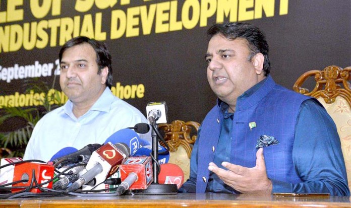 LAHORE: September 26 - Federal Minister for Science and Technology Chaudhry Fawad Hussain talking to media. APP