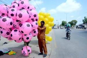 KARACHI: September 19 - A vendor displaying colorful balloons to attract customers. APP Photo by Saeed Qureshi