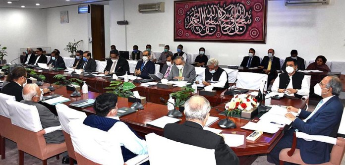 ISLAMABAD: September 09 - Adviser to the Prime Minister on Finance and Revenue, Dr. Abdul Hafeez Shaikh chairing a meeting of the Economic Coordination Committee (ECC) of the Cabinet. APP