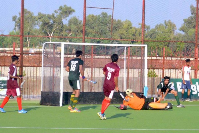 SARGODHA: September 07 - A view of hockey match played between Rashid Minhas Shaheed Hockey Club and Maj. Aziz Bhati Shaheed Hockey Club during Defence Day Hockey Cup at Astroturf Hockey Stadium organized by Sports Department. APP photo by Hassan Mahmood