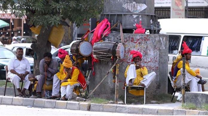 RAWALPINDI: September 25 – Traditional drummers sitting on the roadside while waiting for customers to be hired for events. APP photo by Abid Zia
