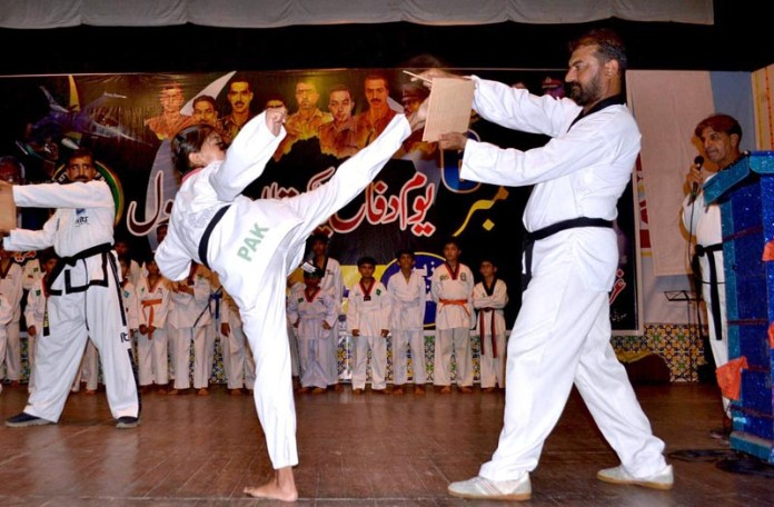 MULTAN: September 06 - Karate players showing her skills during Defence Day of Pakistan at Arts Council organized by Sports and Cultural Federation. APP photo by Safdar Abbas