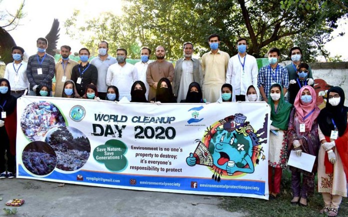 GILGIT: September 19 - Volunteers of Environmental Protection Society in a group photo during cleaning campaign from the banks of river to mark World Cleanup Day with the collaboration of Gilgit-Baltistan Waste Management Company. APP photo by Ashraf Hussain